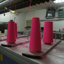 Manufacturing the Cozy - Spools of Cotton Yarn